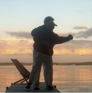 Marc and Kim dancing on the dock at the cottage before she succumbed to the breast cancer.